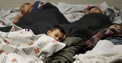 Unaccompanied immigrant youth asleep at a U.S. Detention Center