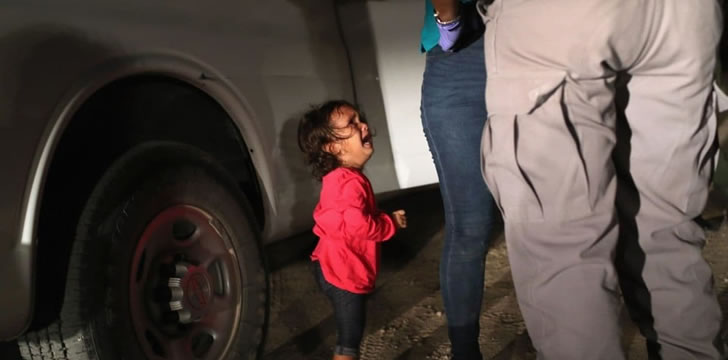 Crying migrant child being spearated from mother due to inhumane Trump policy