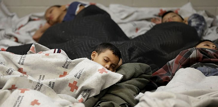 Immigrant Latino kids asleep on the floor at a U.S. Detention Center